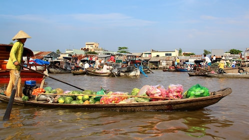 Boat laden with fresh fruit at the floating market in the Mekong Delta