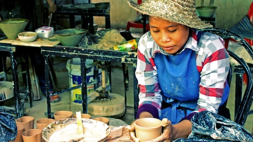 Woman making pottery by hand in Siem Reap