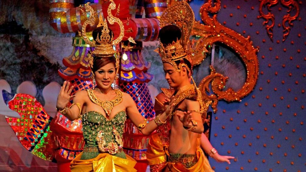 Apri foto 3 di 9. men and woman in costume performing on stage in Cambodia