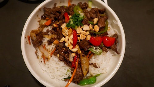 bowl of rice noodles with meat and vegetables in Cambodia