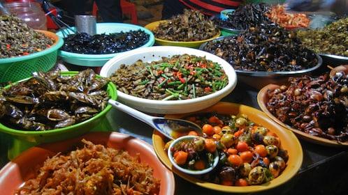 big platters of prepared food in Cambodia
