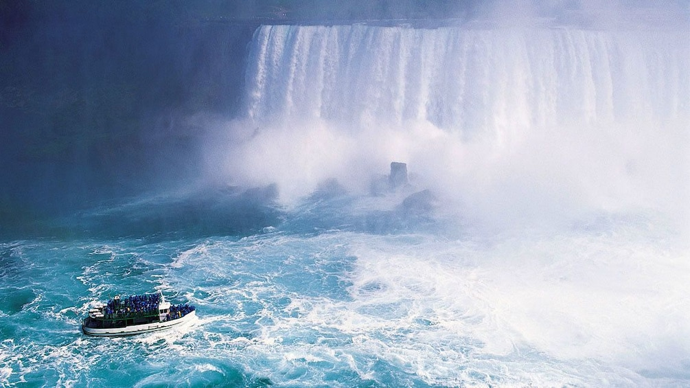 Show item 5 of 5. tour boat nearing the base of the waterfall in Canada