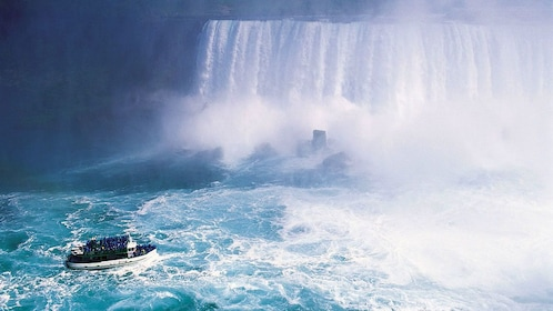 tour boat nearing the base of the waterfall in Canada