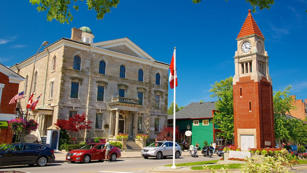 Show item 2 of 5. red brick tower near an old stone building in Canada