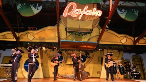 mariachi musicians performing on stage at the Raffain Dinner Show in Brazil