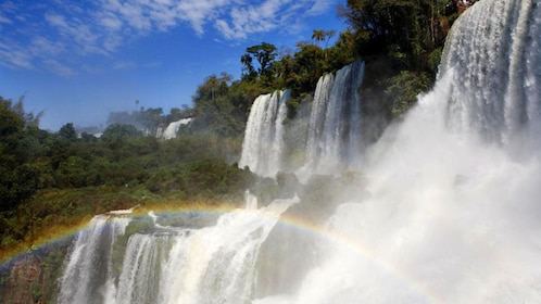 rainbow forming at the waterfall in Brazil