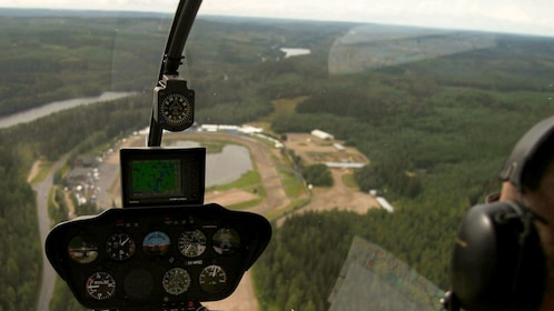 helicopter pilot looking at the dashboard in Brazil