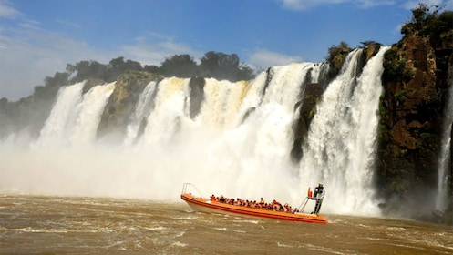 boat traveling along the waterfalls in Argentina