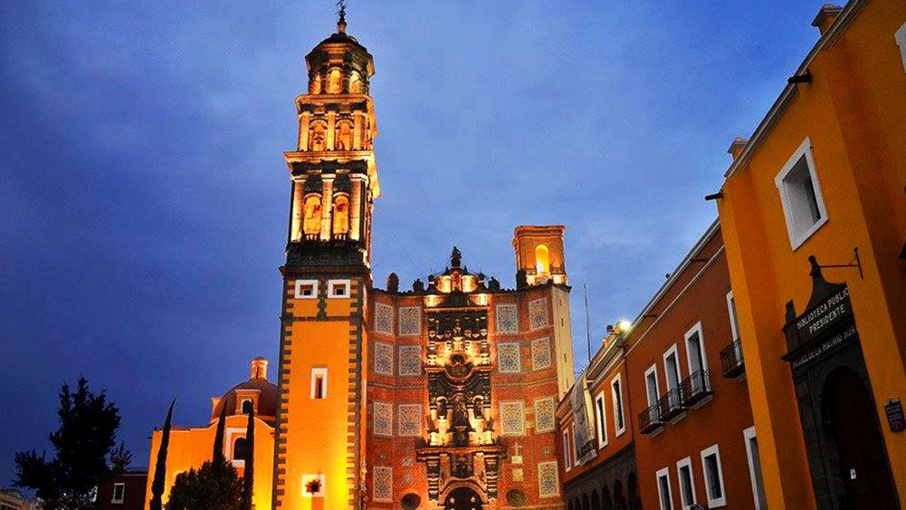 Cathedral lit up at night in Puebla