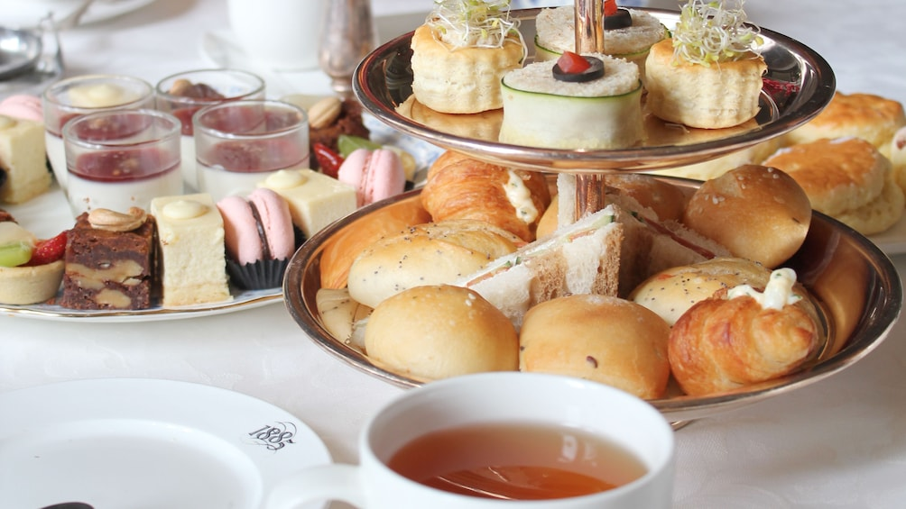 Trays of pastries and desserts at high tea in Penang