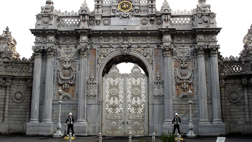 Guards in front of a large ornate gate in Istanbul
