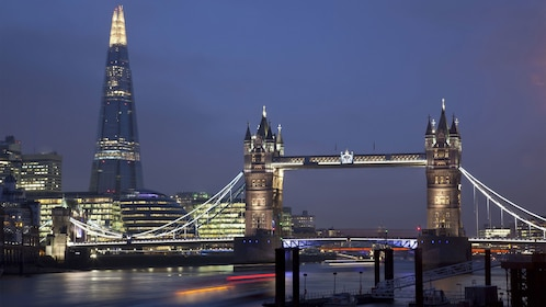 The Shard and London Bridge over the Thames River at night in London
