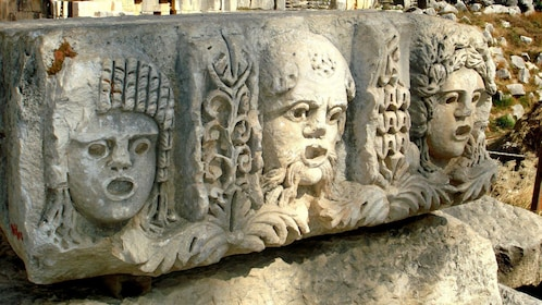 Remains of a relief sculpture with three faces at Demre Myra