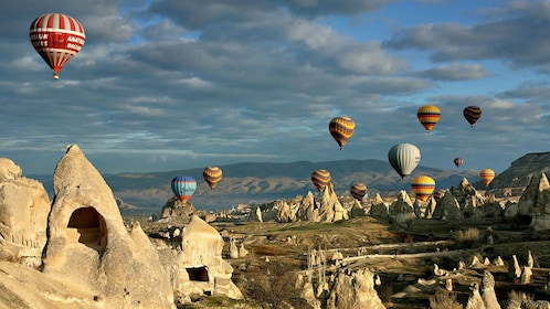Hot hair balloons floating over rock formations in Cappadocia