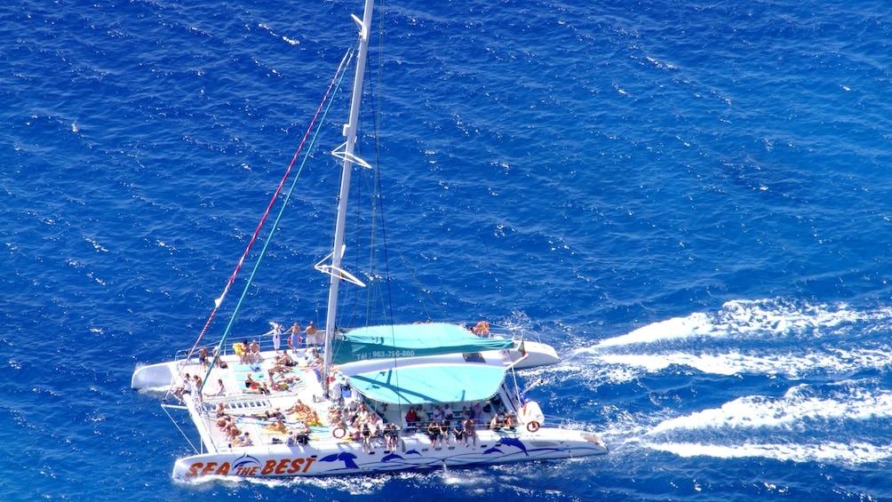 Show item 4 of 5. Catamaran on the water near Madeira Island