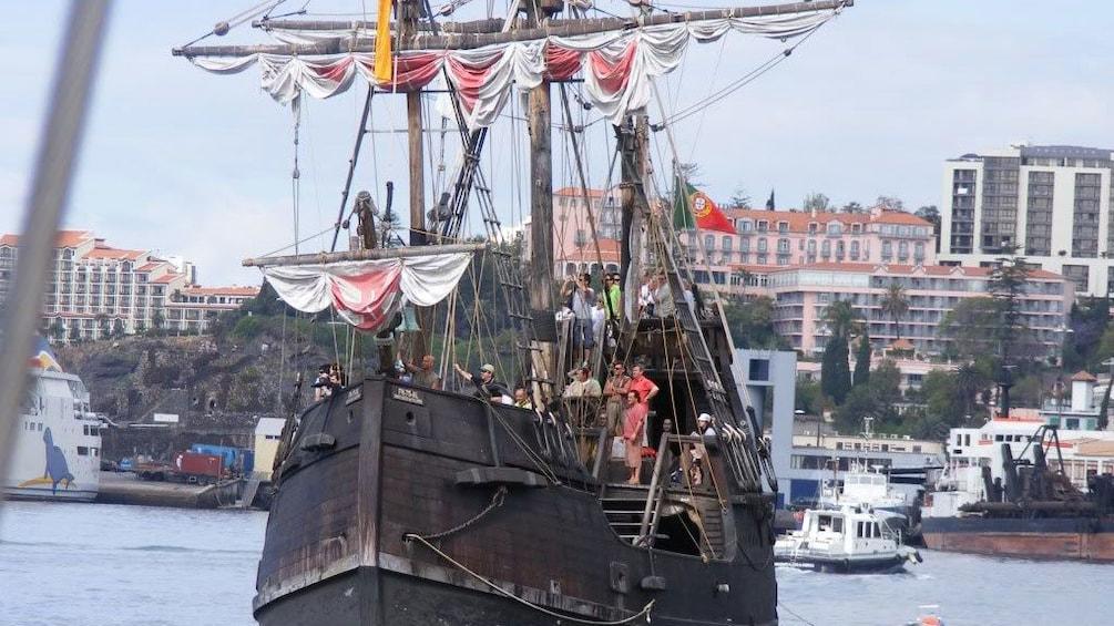 Show item 5 of 5. Nau Santa Maria ship near the harbor in Madeira