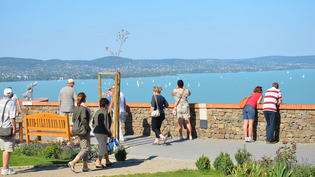 Show item 1 of 10. People looking out at the water at Lake Balaton