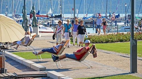 People relaxing by the shore of Lake Balaton