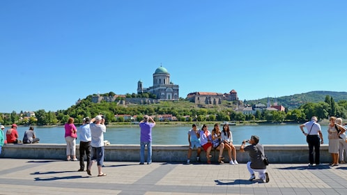 People taking photos on the banks of the Danube river near Budapest