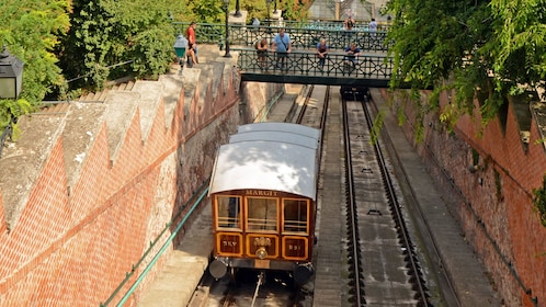 a tram car making its way up hill in budapest