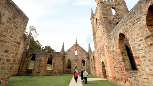 People walking through the ruins of a church in Port Arthur