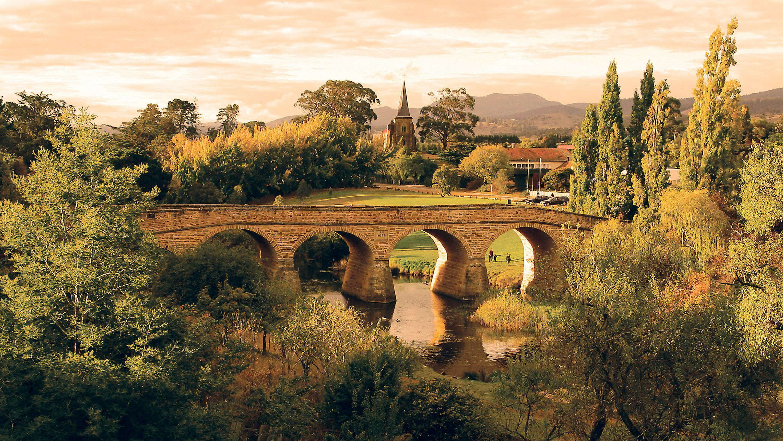 A stone bridge spanning a river in Port Arthur