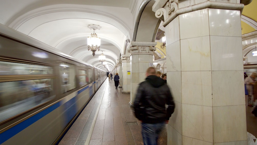 Show item 3 of 5. People coming and going in a moscow metro station