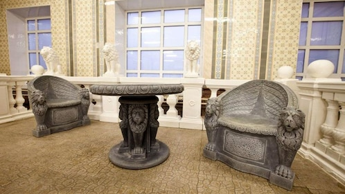 A stone table and chairs at a russian bath in Moscow