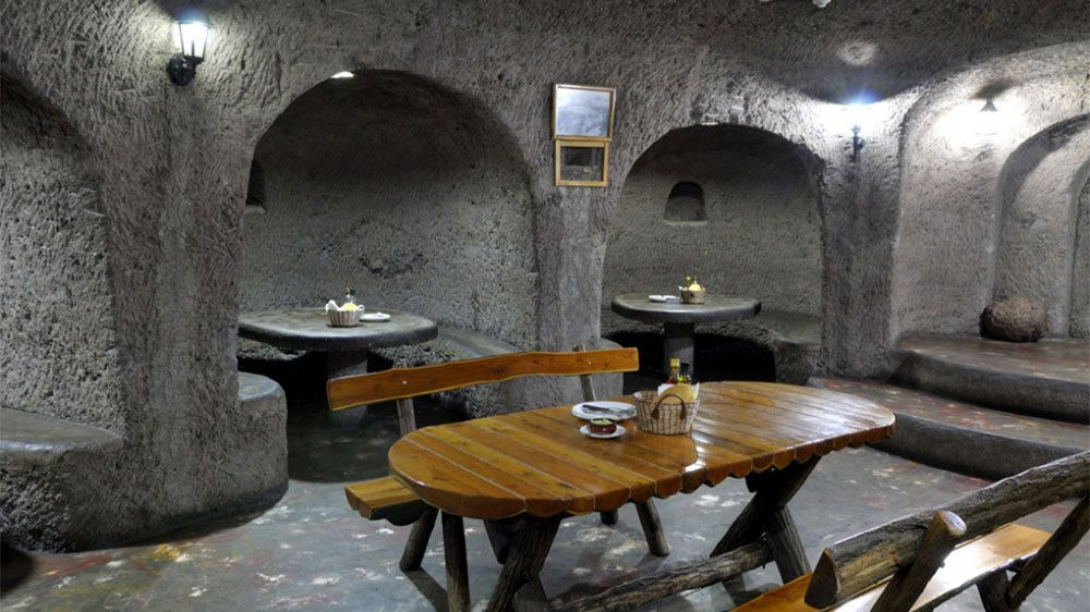 Restaurant with carved stone archways and booths in Gran Canaria