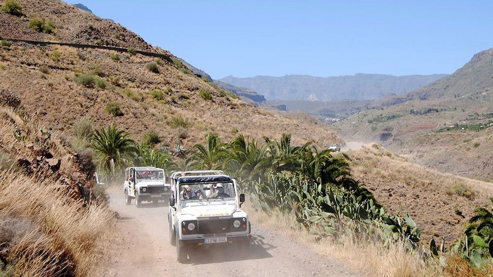 Show item 2 of 5. Jeeps on a dirt road in the hills of Gran Canaria