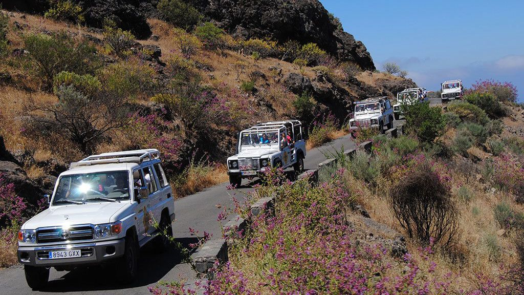 Line of jeeps on a hillside road in Gran Canaria