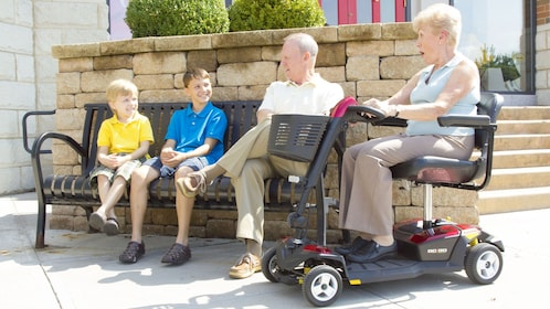 elderly woman accompanying grandsons in Orlando