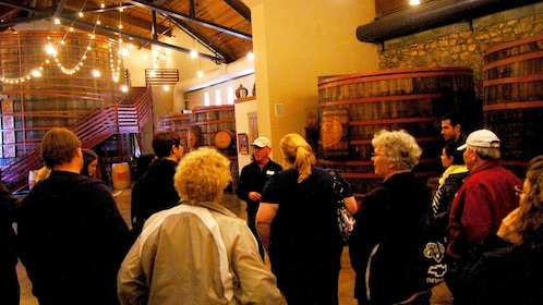 inside the well lit winery with large barrels in San Francisco