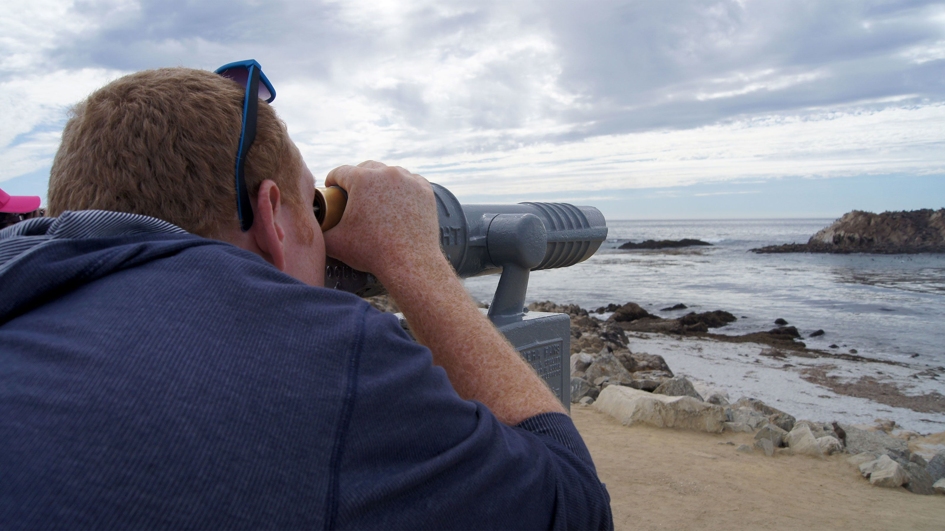 looking out to sea using coin operated binoculars in San Francisco