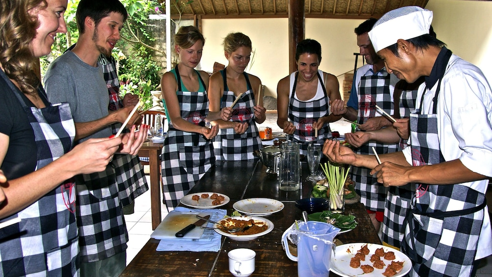 cooking class students wearing aprons in Yangon