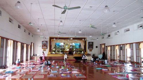 Mats lined up on the floor inside the Mahasi Meditation Center in Myanmar