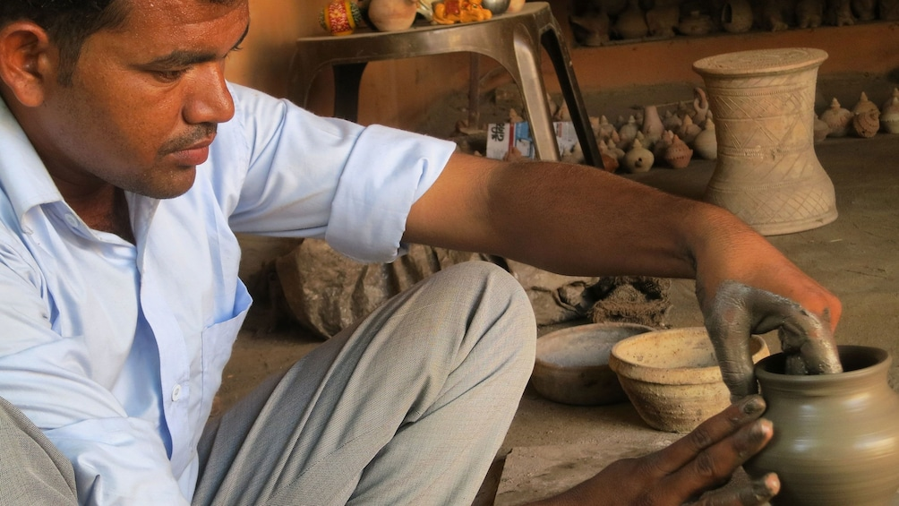 Show item 8 of 8. Craftsman making potter by hand in Myanmar