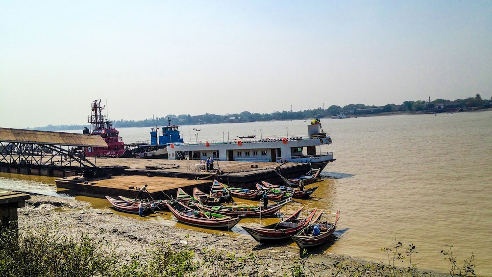 Show item 3 of 8. Boats docked on the bank of the Yangon River in Myanamar