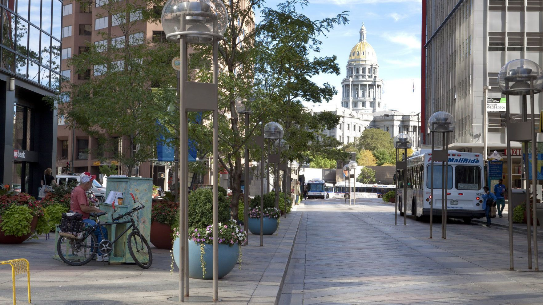 Street through the city center with the Capitol Building in the background in Denver