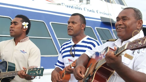 Band performing on a boat in Fiji