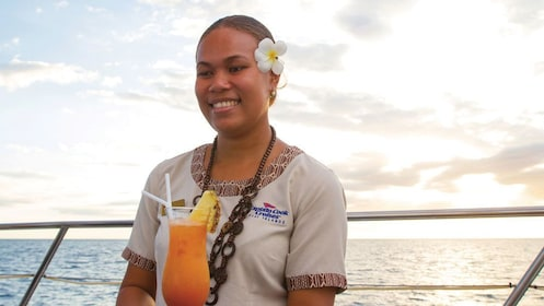 Server with cocktail on a boat in Fiji