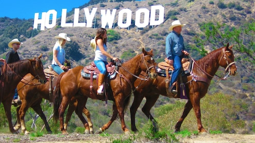 Horseback riding group with Hollywood sign in the background in Hollywood