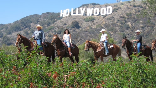 Horseback riding group with the Hollywood sign in the background