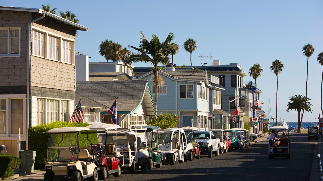 rented golf carts parked along the street near the beach on Catalina Island