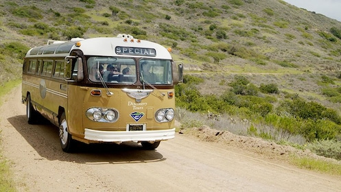 aboard the vintage looking bus on a dirt road in Catalina Island