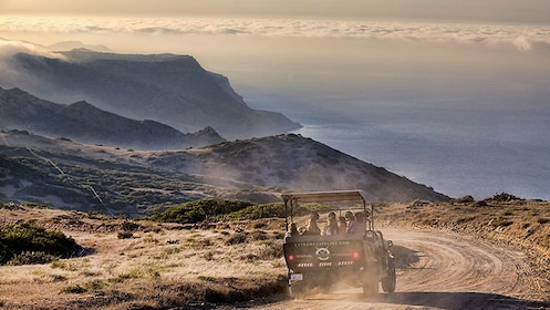 rugged safari vehicle driving along a dirt road along the coastline on Catalina Island