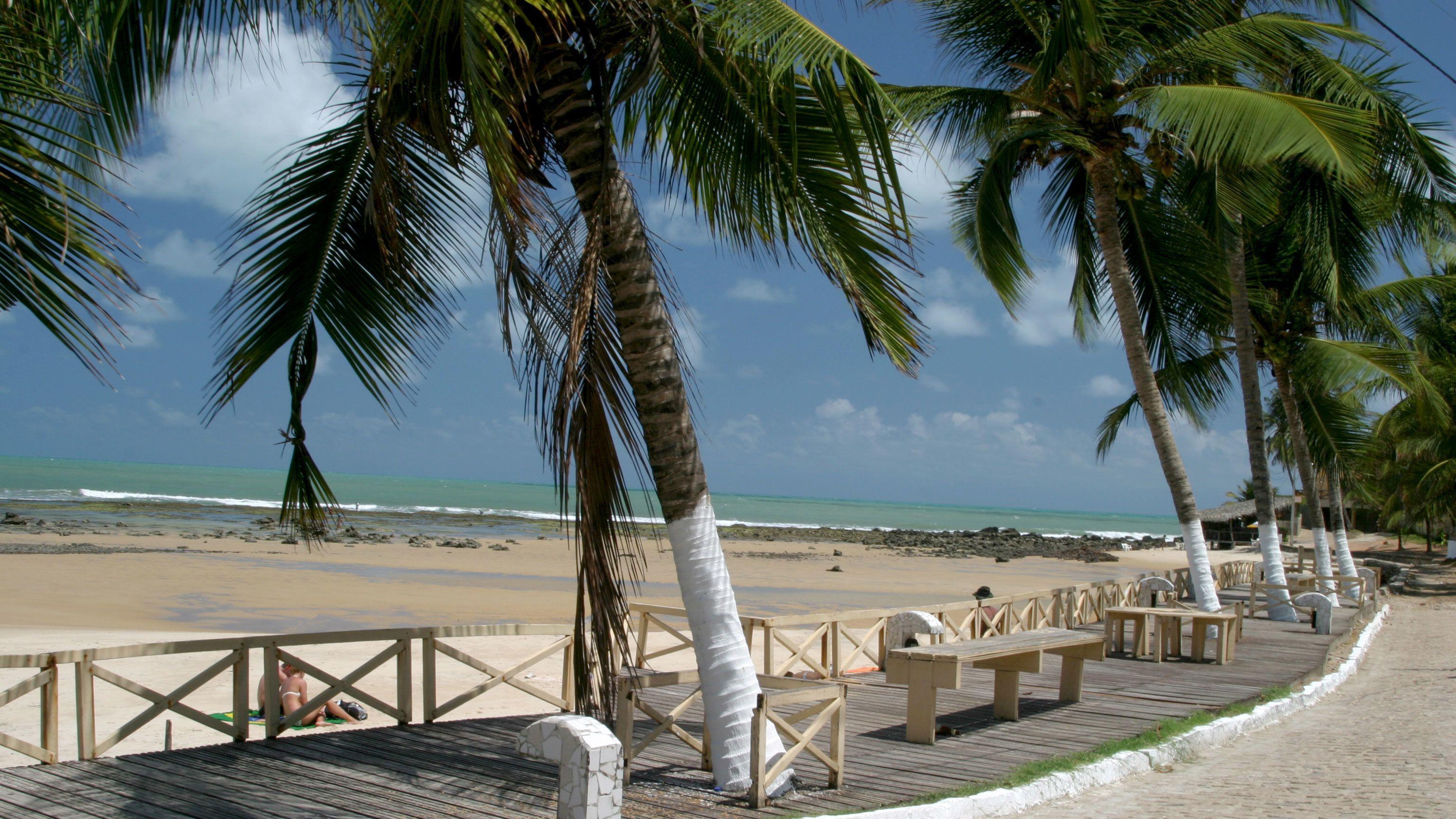 wooden boardwalk along the beach in Natal