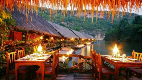 Dining room at a floating hotel on the River Kwai in Thailand