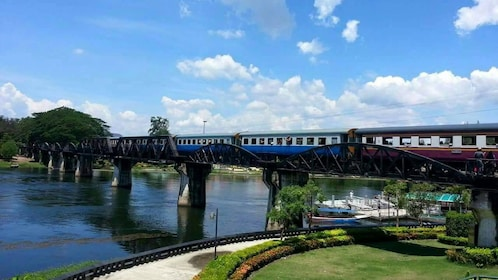 Train on a railway over the River Kwai in Thailand