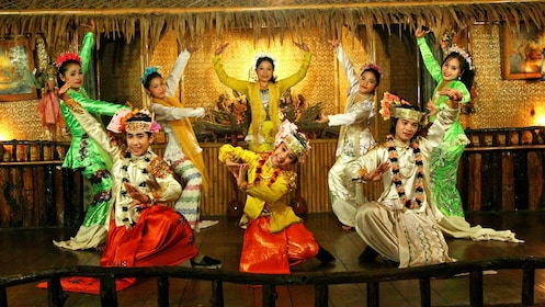 Costumed dancers perform a traditional Mon dance in Thailand